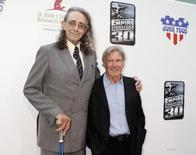 "Original cast members Peter Mayhew (L), who portrayed ""Chewbacca,"" and Harrison Ford, who portrayed Han Solo, attend a screening commemorating the 30th anniversary of ""Star Wars: Episode V The Empire Strikes Back"" in Hollywood May 19, 2010.  REUTERS/Fred Prouser"
