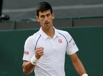 Novak Djokovic of Serbia reacts to breaking serve during his match against Marin Cilic of Croatia at the Wimbledon Tennis Championships in London, July 8, 2015.                           REUTERS/Suzanne Plunkett