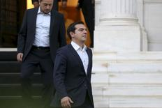 Greek Prime Minister Alexis Tsipras is followed by Minister of State Nikos Pappas (L) and government spokesman Gabriel Sakelaridis (not pictured) as he leaves his office to visit Greek President Prokopis Pavlopoulos in Athens July 8, 2015. REUTERS/Alkis Konstantinidis