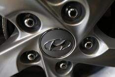 The logo of Hyundai Motor Co. is seen on a wheel of a car at a Hyundai dealership in Seoul January 22, 2015. REUTERS/Kim Hong-Ji
