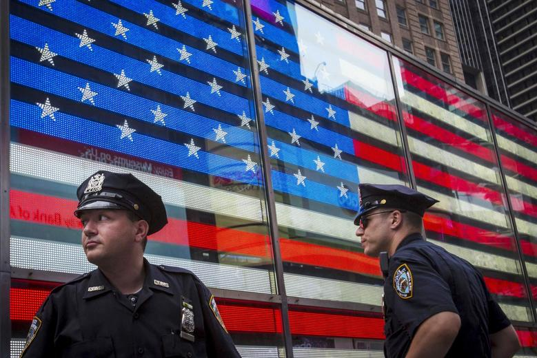 Police officers patrol Times Square in New York, United States, July 3, 2015. REUTERS/Andrew Kelly