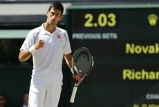 Novak Djokovic of Serbia reacts after breaking serve in the tie break during his match against Richard Gasquet of France at the Wimbledon Tennis Championships in London, July 10, 2015.    REUTERS/Suzanne Plunkett