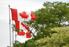 Jul 9, 2015; Toronto, Ontario, Canada; Canadian flags are seen in preparation for the 2015 Pan Am Games. Mandatory Credit: John David Mercer-USA TODAY Sports