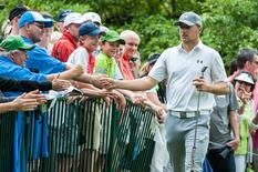 Jordan Spieth is greeted by fans as he walks to the opening hole of the third round of the John Deere Classic at TPC Deere Run. Mandatory Credit: Jeffrey Becker-USA TODAY Sports
