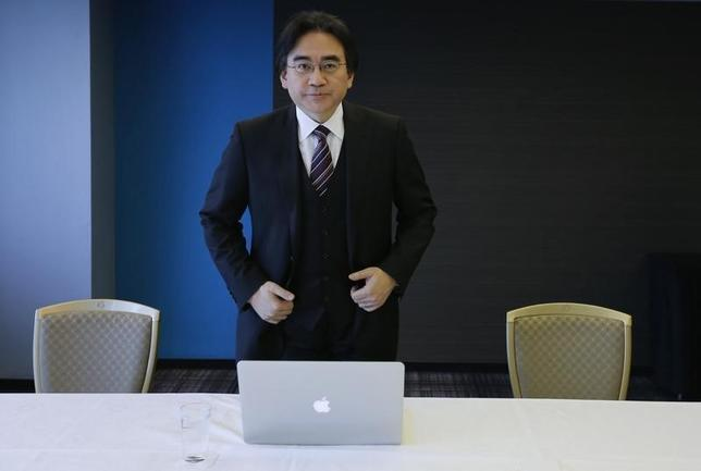 Nintendo Co's President and Chief Executive Satoru Iwata attends an interview with Reuters in Tokyo in this file May 8, 2014 photo. REUTERS/Toru Hanai