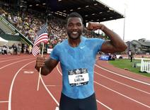 Justin Gatlin poses with a United States flag after winning the 200m in a meet record 19.57 in the 2015 USA Championships at  Hayward Field. Mandatory Credit: Kirby Lee-USA TODAY Sports