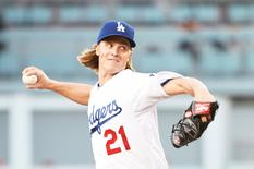 Jul 9, 2015; Los Angeles, CA, USA;  Los Angeles Dodgers starting pitcher Zack Greinke (21) works against the Philadelphia Phillies in the second inning at Dodger Stadium. Mandatory Credit: Richard Mackson-USA TODAY Sports