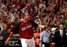 Jul 13, 2015; Cincinnati, OH, USA; National League third baseman Todd Frazier (21) of the Cincinnati Reds watches his winning home run during the 2015 Home Run Derby the day before the MLB All Star Game at Great American Ballpark. Mandatory Credit: David Kohl-USA TODAY Sports