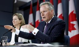 Bank of Canada Governor Stephen Poloz speaks during a news conference with Senior Deputy Governor Carolyn Wilkins upon the release of the Monetary Policy Report in Ottawa, Canada July 15, 2015. REUTERS/Chris Wattie