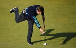 Nick Faldo of England reacts to a missed putt on the 17th hole during the Champion Golfers' Challenge tournament ahead of the British Open golf championship on the Old Course in St. Andrews, Scotland, July 15, 2015.      REUTERS/Lee Smith