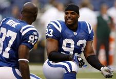 Indianapolis Colts defensive end Dwight Freeney (R) talks with Colts wide receiver Reggie Wayne on the field before their NFL football game versus the Green Bay Packers in Indianapolis August 26, 2011.   REUTERS/Brent Smith