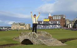 Nick Faldo of England poses on The Swilcan Bridge on the 18th hole during the second round of the British Open golf championship on the Old Course in St. Andrews, Scotland, July 17, 2015. Faldo is playing in his last Open golf championship at St. Andrews.    REUTERS/Eddie Keogh