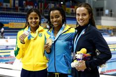 Etiene Medeiros of Brazil (left) , Arianna Vanderpool-Walllace of the Bahamas (middle) and Natalie Coughlin of the United States (right) pose with their medals after the women's 50m freestyle final the 2015 Pan Am Games at Pan Am Aquatics UTS Centre and Field House. Erich Schlegel-USA TODAY Sports
