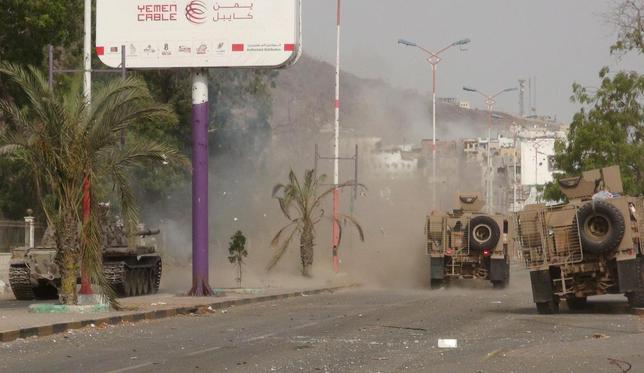 Military vehicles of the Southern Resistance fighters move during clashes with Houthi fighters on a street in Yemen's southern port city of Aden July 17, 2015. REUTERS/Stringer