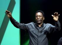 Legendary Brazilian soccer player Pele waves to the crowd after speaking during Electronic Arts media briefing before the opening day of the Electronic Entertainment Expo, or E3, at the Shrine Auditorium in Los Angeles, California June 15, 2015.   REUTERS/Kevork Djansezian      TPX IMAGES OF THE DAY      - RTX1GN6H
