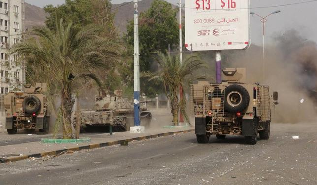 Military vehicles of the Southern Resistance fighters move during clashes with Houthi fighters on a street in Yemen's southern port city of Aden July 17, 2015.REUTERS/Stringer