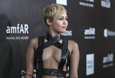 Singer Miley Cyrus poses at the amfAR's Fifth Annual Inspiration Gala in Los Angeles, California October 29, 2014.  REUTERS/Mario Anzuoni