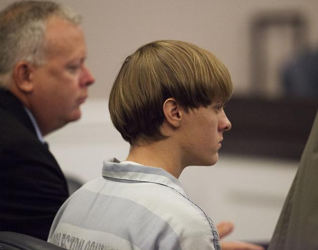 Dylann Roof [R), the 21-year-old man charged with murdering nine worshippers at a historic black church in Charleston last month, listens to the proceedings with assistant defense attorney William Maguire during a hearing at the Judicial Center in Charleston, South Carolina July 16, 2015. REUTERS/Randall Hill