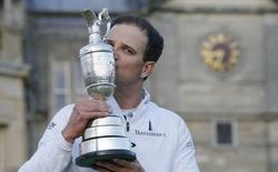 Zach Johnson of the U.S. celebrates as he kisses the Claret Jug after winning the British Open golf championship on the Old Course in St. Andrews, Scotland, July 20, 2015. REUTERS/Paul Childs