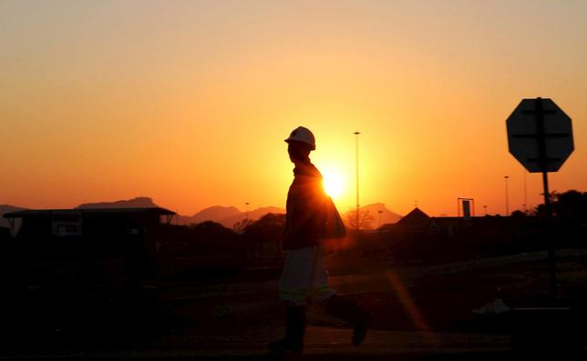 A miner returns from his shift in Nkaneng township outside the Lonmin mine in Rustenburg, northwest of Johannesburg, June 26, 2015.  REUTERS/Siphiwe Sibeko