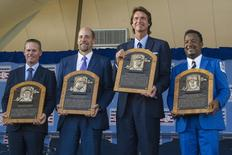 Hall of Fame Inductee Craig Biggio (L), Hall of Fame Inductee John Smoltz (left center), Hall of Fame Inductee Randy Johnson (right center), and Hall of Fame Inductee Pedro Martinez (R) hold their plagues up for a photo during the Hall of Fame Induction Ceremonies at Clark Sports Center. Mandatory Credit: Gregory J. Fisher-USA TODAY Sports