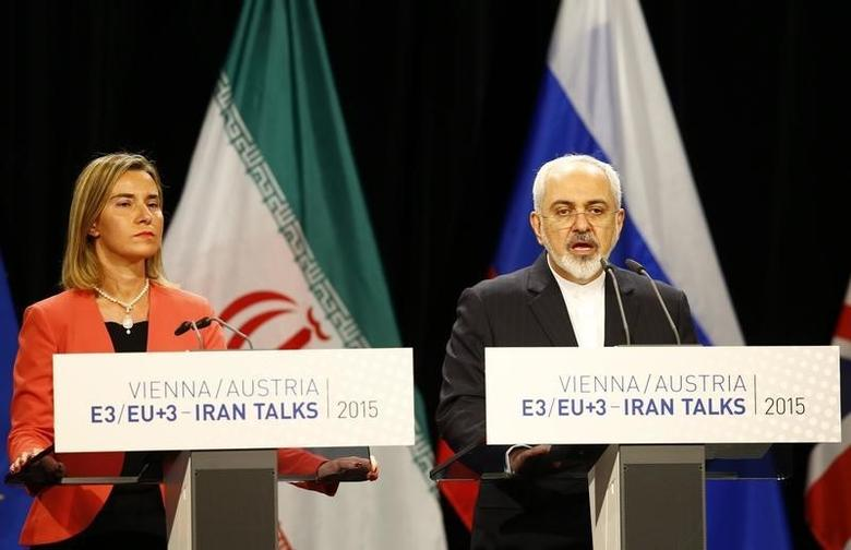 Iranian Foreign Minister Mohammad Javad Zarif addresses during a joint news conference with High Representative of the European Union for Foreign Affairs and Security Policy Federica Mogherini (L) after a plenary session at the United Nations building in Vienna, Austria July 14, 2015. REUTERS/Leonhard Foeger