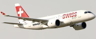 A new Bombardier CS100 passenger jet of Swiss airline flies over Zurich airport near the town of Kloten June 17, 2015. REUTERS/Arnd Wiegmann
