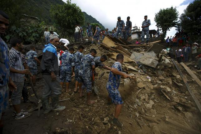 Rescue team members search for the landslide victims at Lumle village in Kaski district July 30, 2015. REUTERS/Navesh Chitrakar