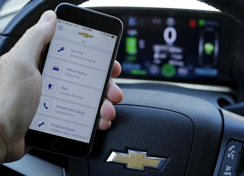 A mobile phone displays the OnStar app inside a Chevrolet Volt vehicle in this photo illustration taken in  Encinitas, California, July 30, 2015. REUTERS/Mike Blake