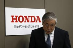 Tetsuo Iwamura, Executive Vice President of Honda Motor Co, walks into a news conference at the company's headquarters in Tokyo October 28, 2014. Honda Motor Co Ltd cut its sales forecasts for this year citing competition in Japan and China as well as the impact of recalls on new model launches, but said a weak yen will help it stick to its operating profit estimate at 770 billion yen. REUTERS/Yuya Shino (JAPAN - Tags: TRANSPORT BUSINESS) - RTR4BU8K