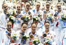 Members of team Russia pose with their gold medals after the women's synchronised swimming free routine combination final at the Aquatics World Championships in Kazan, Russia August 1, 2015.    REUTERS/Hannibal Hanschke