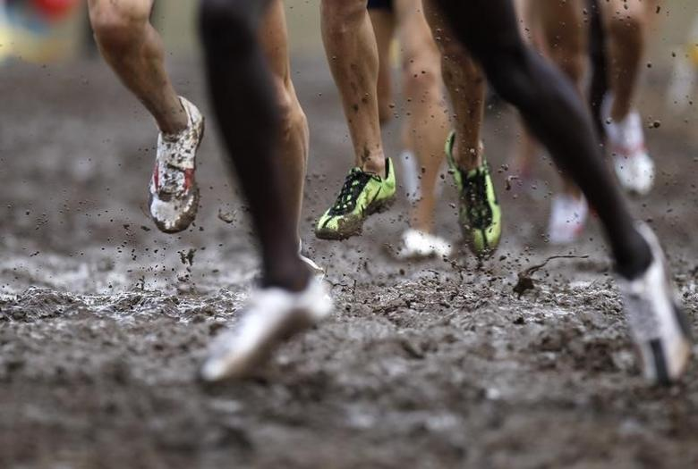 Competitors run during the men's senior race at the IAAF World Cross Country Championships in Bydgoszcz in this file photo taken on March 28, 2010. REUTERS/Peter Andrews