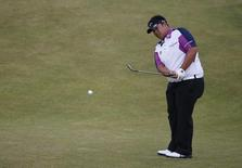 Kiradech Aphibarnrat of Thailand chips onto the 12th green during a practice round ahead of the British Open golf championship on the Old Course in St. Andrews, Scotland, in this file photo taken on July 14, 2015. REUTERS/Russell Cheyne