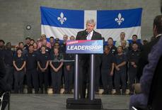 Canadian Prime Minister Stephen Harper speaks to supporters and employees at Spectra Premium during a campaign stop in Laval, Quebec, August 3, 2015. REUTERS/Christinne Muschi