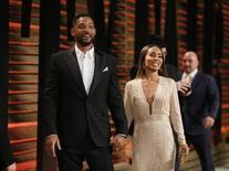 Smith e sua mulher, Jada Pinkett Smith, em evento em Hollywood.  2/3/2014. REUTERS/Danny Moloshok