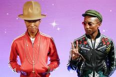 Musician Pharrell Williams makes peace symbol as he meets his wax double at Madame Tussauds in New York April 1, 2015. REUTERS/Eduardo Munoz