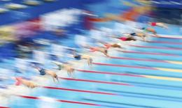 Competitors start in a men's 100m freestyle heat at the Aquatics World Championships in Kazan, Russia, August 5, 2015. REUTERS/Hannibal Hanschke
