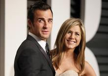 Actress Jennifer Aniston and fiance Justin Theroux arrive at the 2015 Vanity Fair Oscar Party in Beverly Hills, California, in this file photo taken February 22, 2015. REUTERS/Danny Moloshok/Files