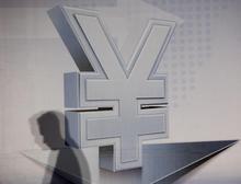 图中为人民币标识符号。REUTERS/Bobby Yip