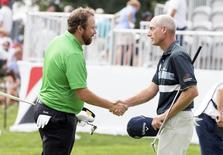 Shane Lowry (l) and Jim Furyk shake hands after finishing the third round of the Bridgestone Invitational at Firestone Country Club - South Course. Mandatory Credit: Greg Bartram-USA TODAY Sports