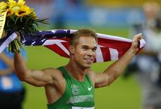 Nick Symmonds of the U.S. celebrates after winning the men's 800 metres at the Weltklasse Diamond League athletics meeting in Zurich August 29, 2013.    REUTERS/Ruben Sprich