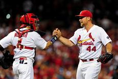 Aug 11, 2015; St. Louis, MO, USA; St. Louis Cardinals relief pitcher Trevor Rosenthal (44) celebrates with catcher Yadier Molina (4) after defeating the Pittsburgh Pirates at Busch Stadium. The Cardinals defeated the Pirates 4-3. Mandatory Credit: Jeff Curry-USA TODAY Sports