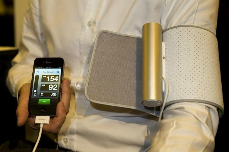A Withings Smart Blood Pressure Monitor with an iPhone connection is displayed during a media preview event for the 2011 International Consumer Electronics Show (CES) in Las Vegas, Nevada January 4, 2011. The device allows for home monitoring of blood pressure but also uploads the information to an Internet site that your doctor can access. The annual convention, the world's largest consumer technology trade show, begins January 6. REUTERS/Steve Marcus (UNITED STATES - Tags: BUSINESS SCI TECH HEALTH) - RTXW7TI