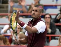 Aug 11, 2015; Montreal, Quebec, Canada; Nick Kyrgios of Australia reacts after winning his match against Fernando Verdasco of Spain (not pictured) during the Rogers Cup tennis tournament at Uniprix Stadium. Eric Bolte-USA TODAY Sports