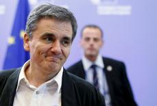 Le ministre grec des Finances, Euclide Tsakalotos. Les ministres des Finances de la zone euro ont donné vendredi leur feu vert à un plan d'aide à la Grèce de jusqu'à 86 milliards d'euros sur trois ans. Après six heures de discussions, l'Eurogroupe a validé comme prévu le protocole d'accord établi entre le gouvernement grec et ses créanciers internationaux, que le parlement grec avait précédemment ratifié. /Photo prise le 14 août 2015/REUTERS/François Lenoir