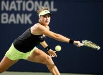 Aug 14, 2015; Toronto, Ontario, Canada; Belinda Bencic (SUI) goes to return a ball against Ana Ivanovic (not pictured) during the quarter finals of the Rogers Cup tennis tournament at Aviva Centre. Mandatory Credit: John E. Sokolowski-USA TODAY Sports