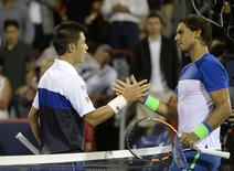 Aug 14, 2015; Montreal, Quebec, Canada; Kei Nishikori of Japan and Rafael Nadal of Spain shake hands after their match during the Rogers Cup tennis tournament at Uniprix Stadium. Mandatory Credit: Eric Bolte-USA TODAY Sports