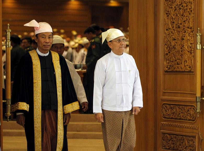 Shwe Man (L), Speaker of the Union Parliament, and Myanmar's President Thein Sein exit after he gave a speech at the regular 9th section of the Union parliament on the final day in Nyapyitaw in this March 26, 2014 file photo.  REUTERS/Soe Zeya Tun