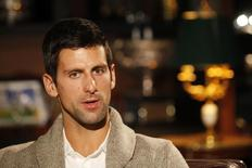 Tennis player Novak Djokovic of Serbia talks during an interview in Belgrade March 1, 2015.  REUTERS/Djordje Kojadinovic