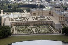 The Chateau de Versailles (Versailles Palace) is seen in an aerial view outside Paris July 14, 2011.  REUTERS/Charles Platiau